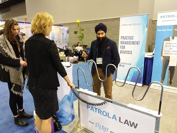 Dental Professional at Patrola Law's Booth